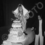 Scorpions, France Tour Mar '82, © 1982 Robert EllisRepfoto… Matthias takes a bite out of the scorpion on top of the backstage celebratory cake from Albert Koski the promoter.